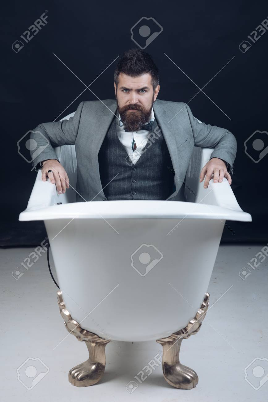 Hipster With Stylish Appearance In Luxury Old Fashioned Bathtub ...