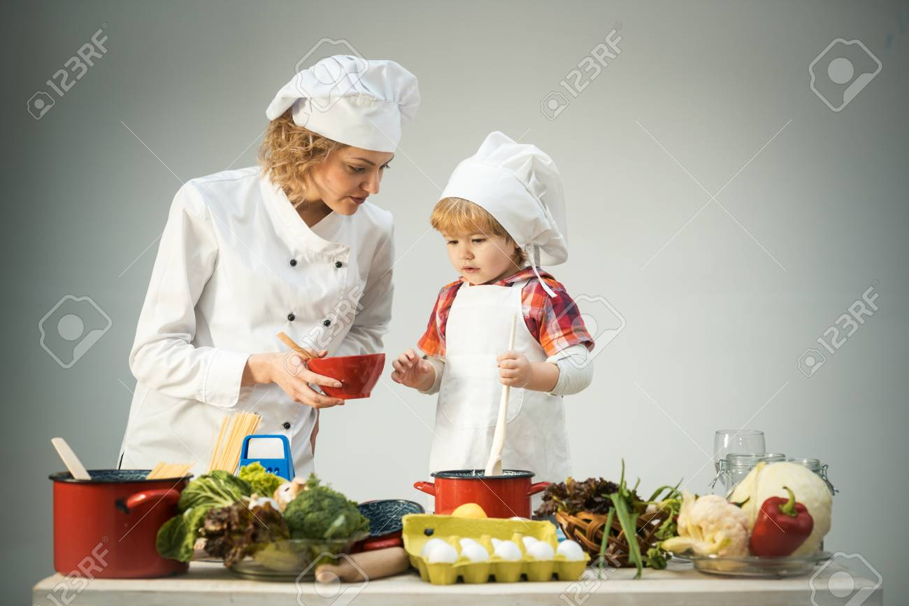 Chef And Assistant Near Kitchen Equipment And Food Products... Stock ...