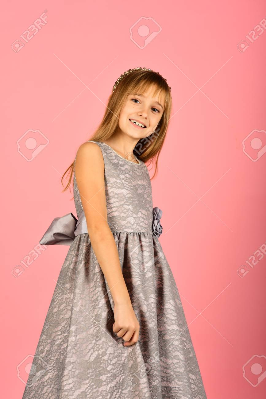 57b8a13a90cb Child girl in stylish glamour dress, elegance. Look, hairdresser, makeup.  Fashion