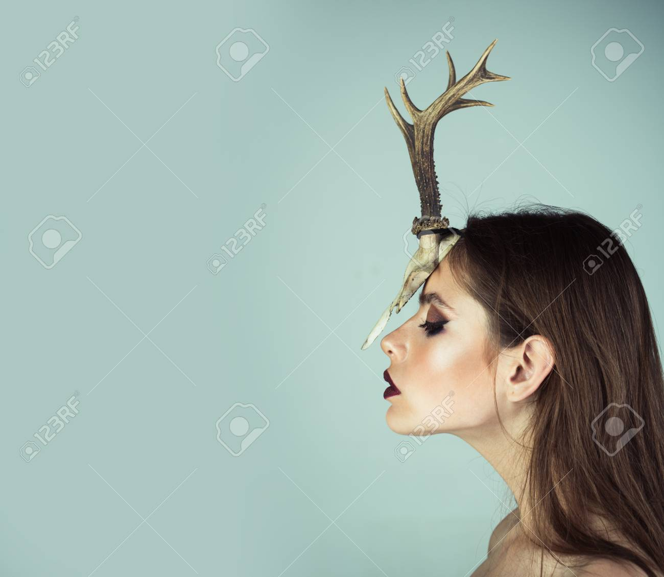 and antlers fashion devil of mystic shaman girl with horns beauty look and cosmetics for skincare dark fantasy creature elf on halloween in skull