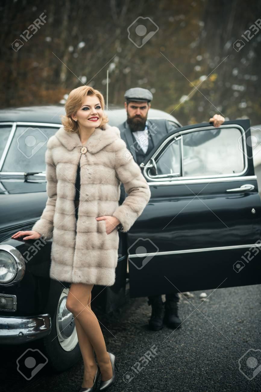 Fur coat and young escort