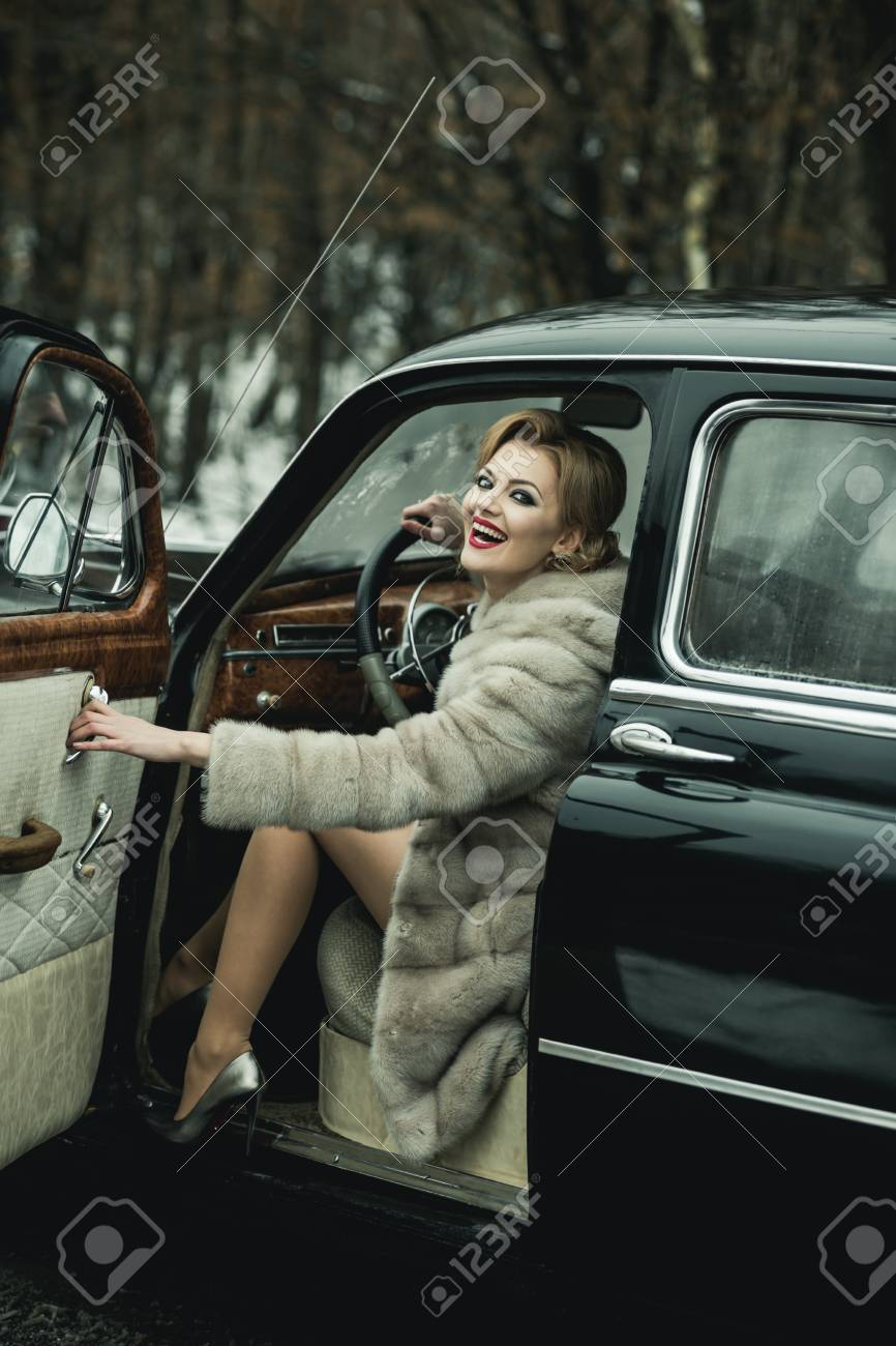 Call girl in vintage car  call girl with stylish hair and fashionable