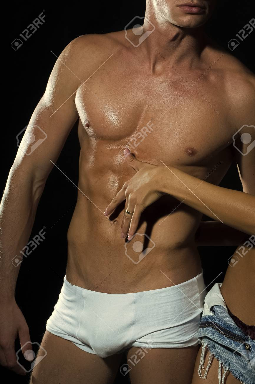 Male torso. Sexual young naked pair of muscular boy in white..