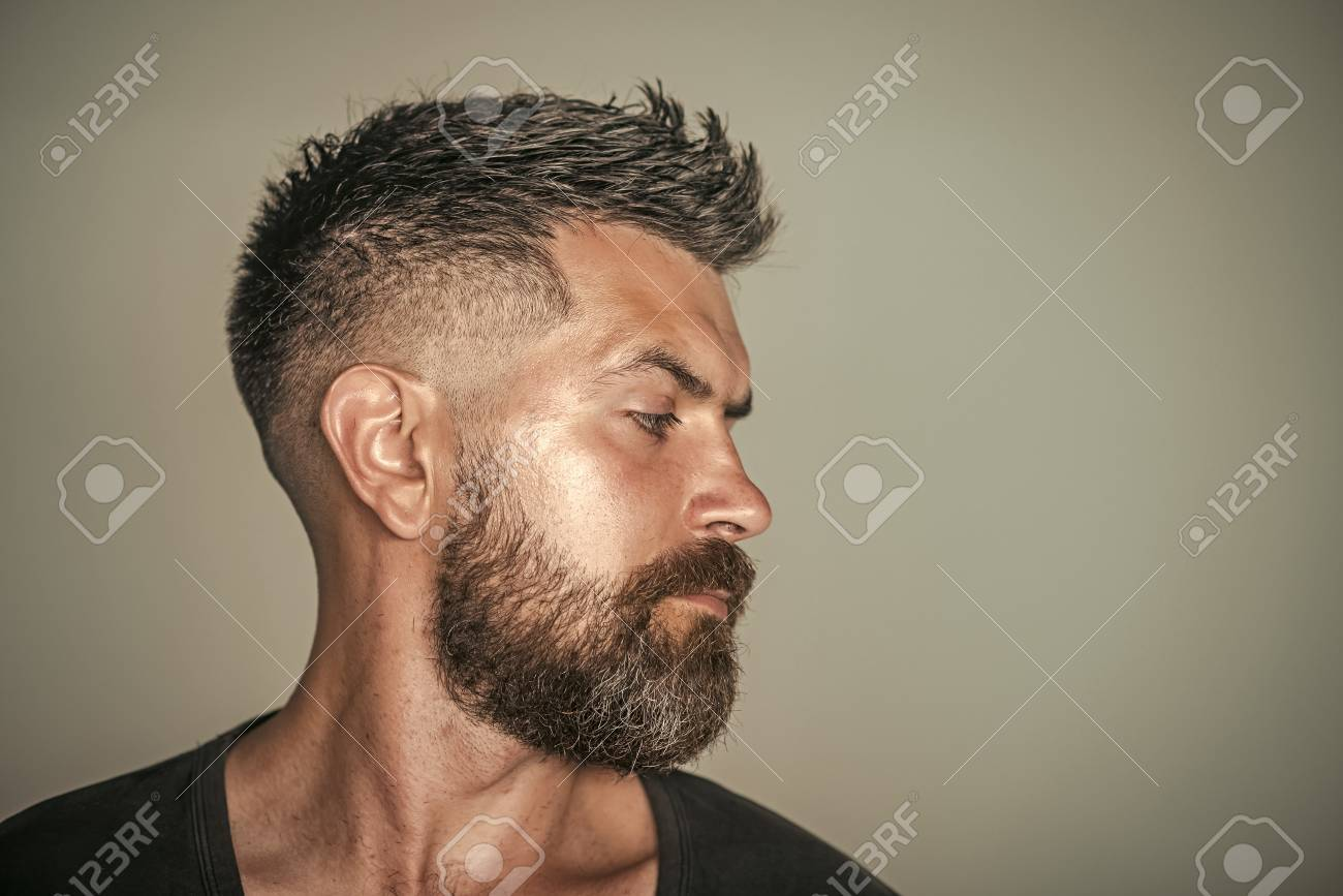 Barber shop. Hair style. Man with bearded face profile and stylish hair - 102646851