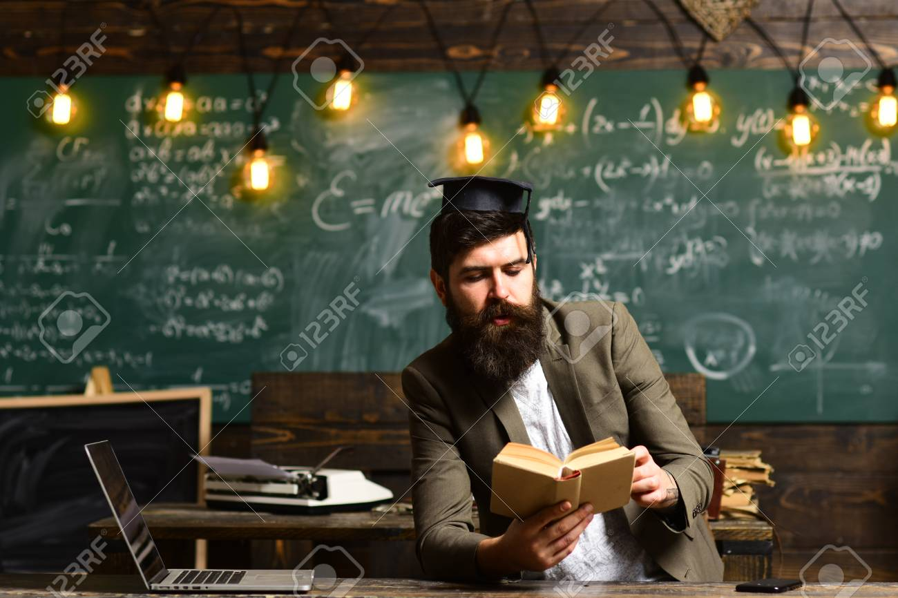 Bearded Man Read Book In Classroom Scientist Hipster With Book