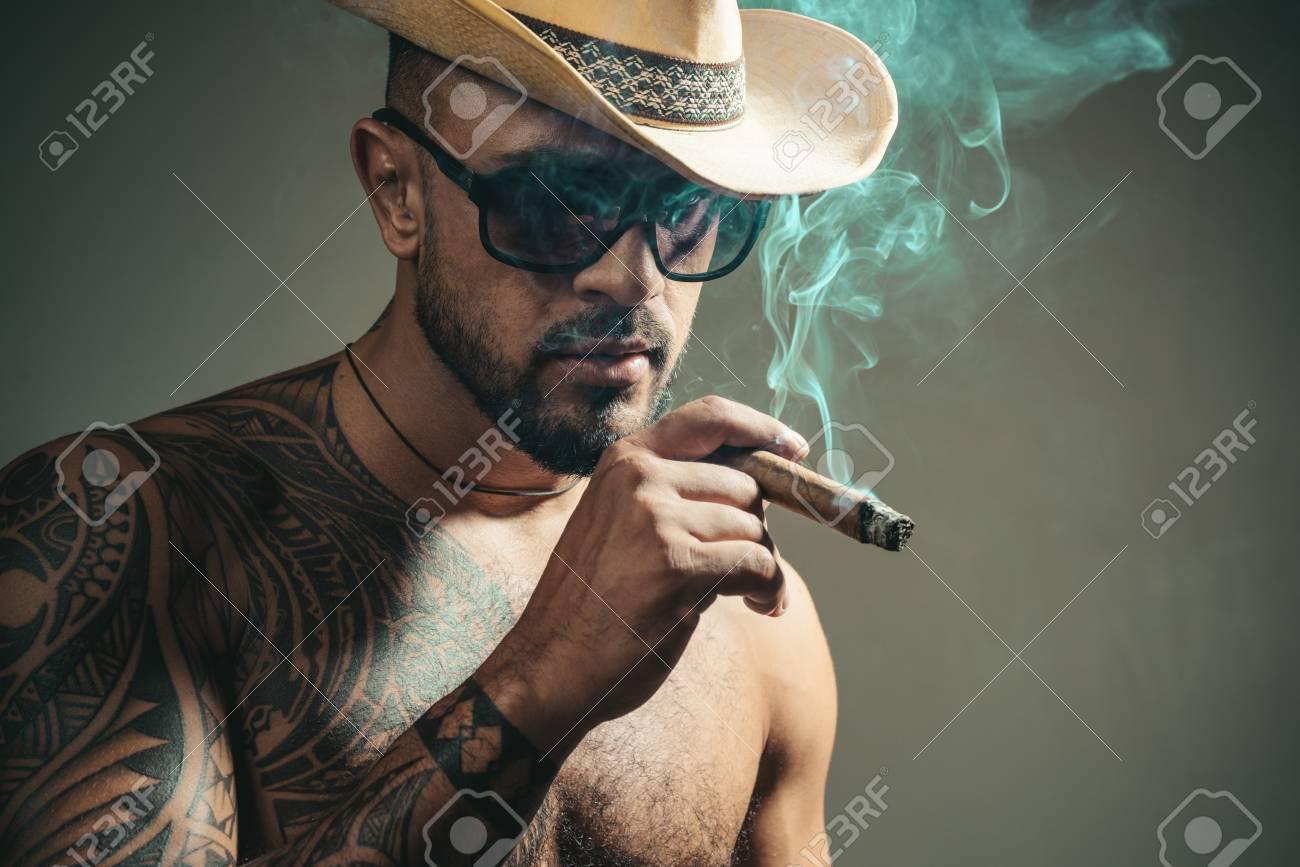 0ff67402a Cuban cigars. Portrait of latin face with a sensual look. Cuban..