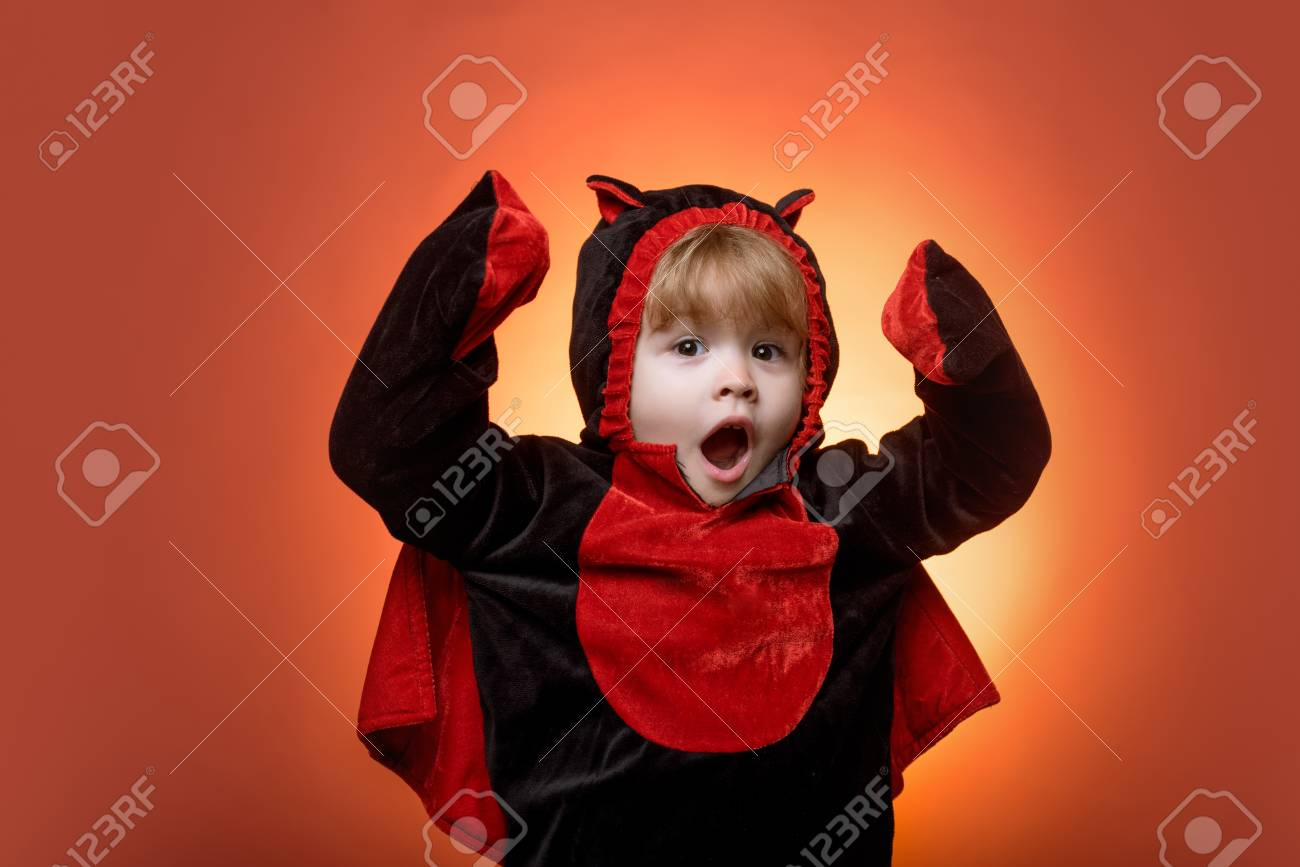 Funny Kids Halloween Costumes.Happy Kids On Halloween Funny Kids In Carnival Costumes On Orange