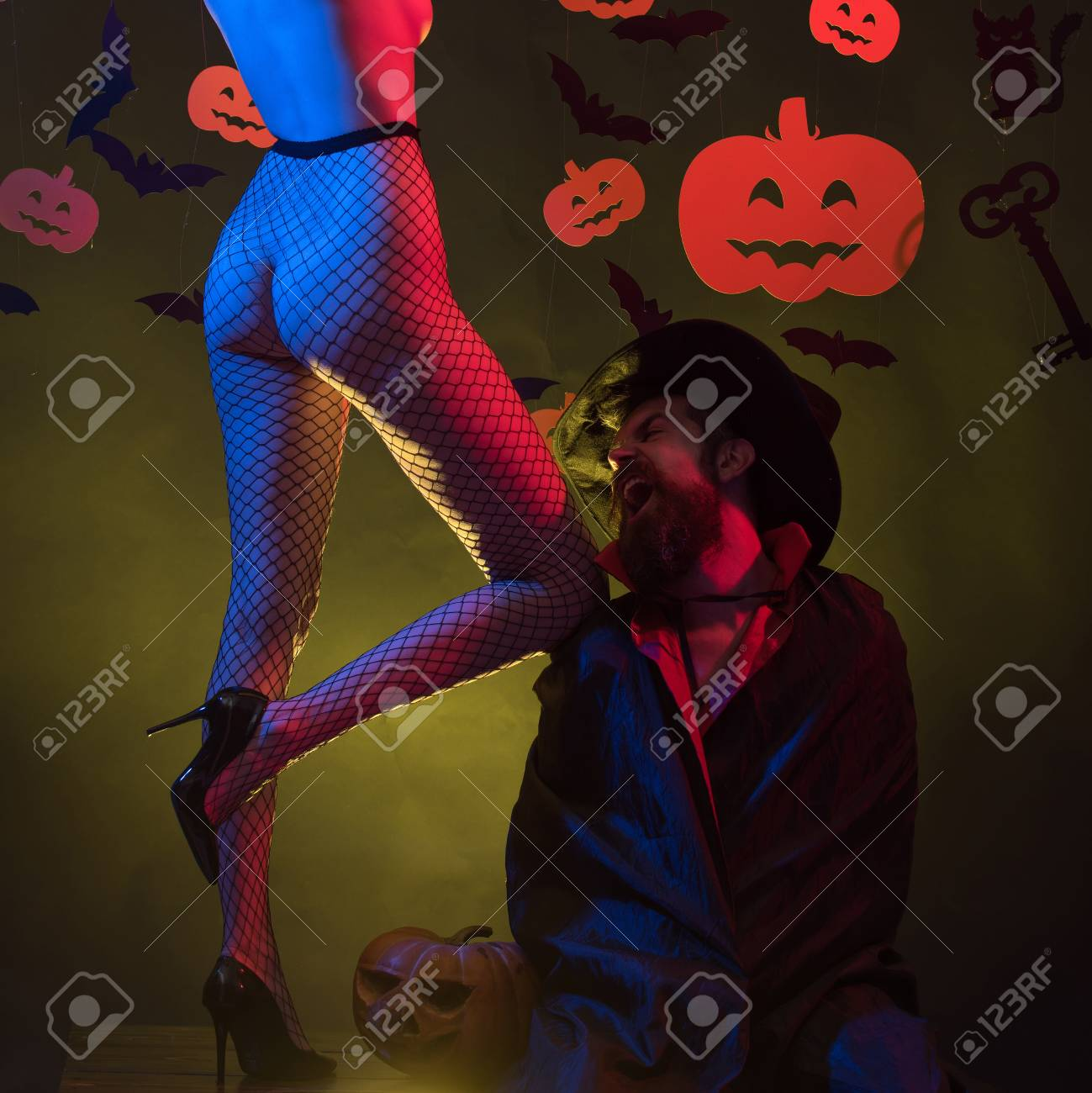 ... ass or butt. Night Party background. Sexy Horror background. Holiday  halloween with funny carnival costumes on a halloween background. Romantic  couple.