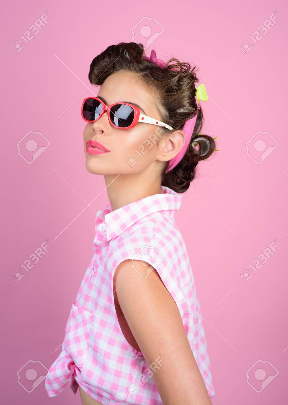 Pin up girl. happy girl in summer glasses. retro woman with fashion..