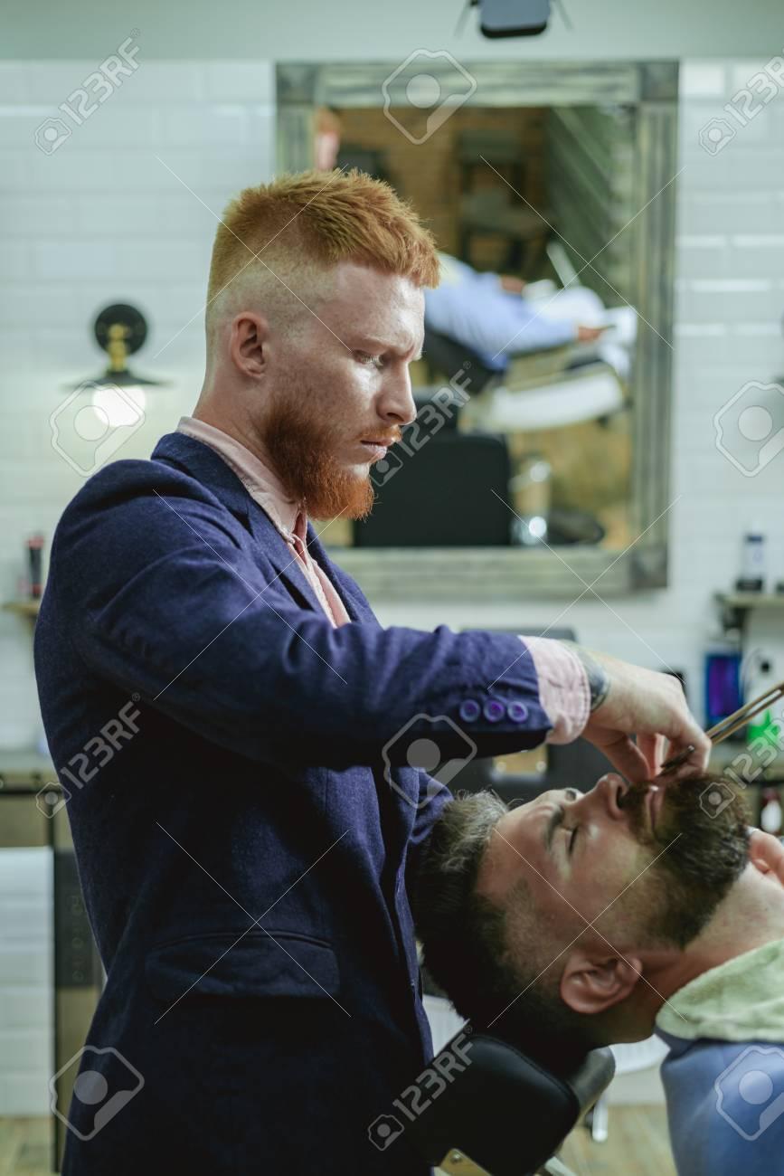 Hair Salon And Barber Vintage. Brutal Guy In Modern Barber Shop ...