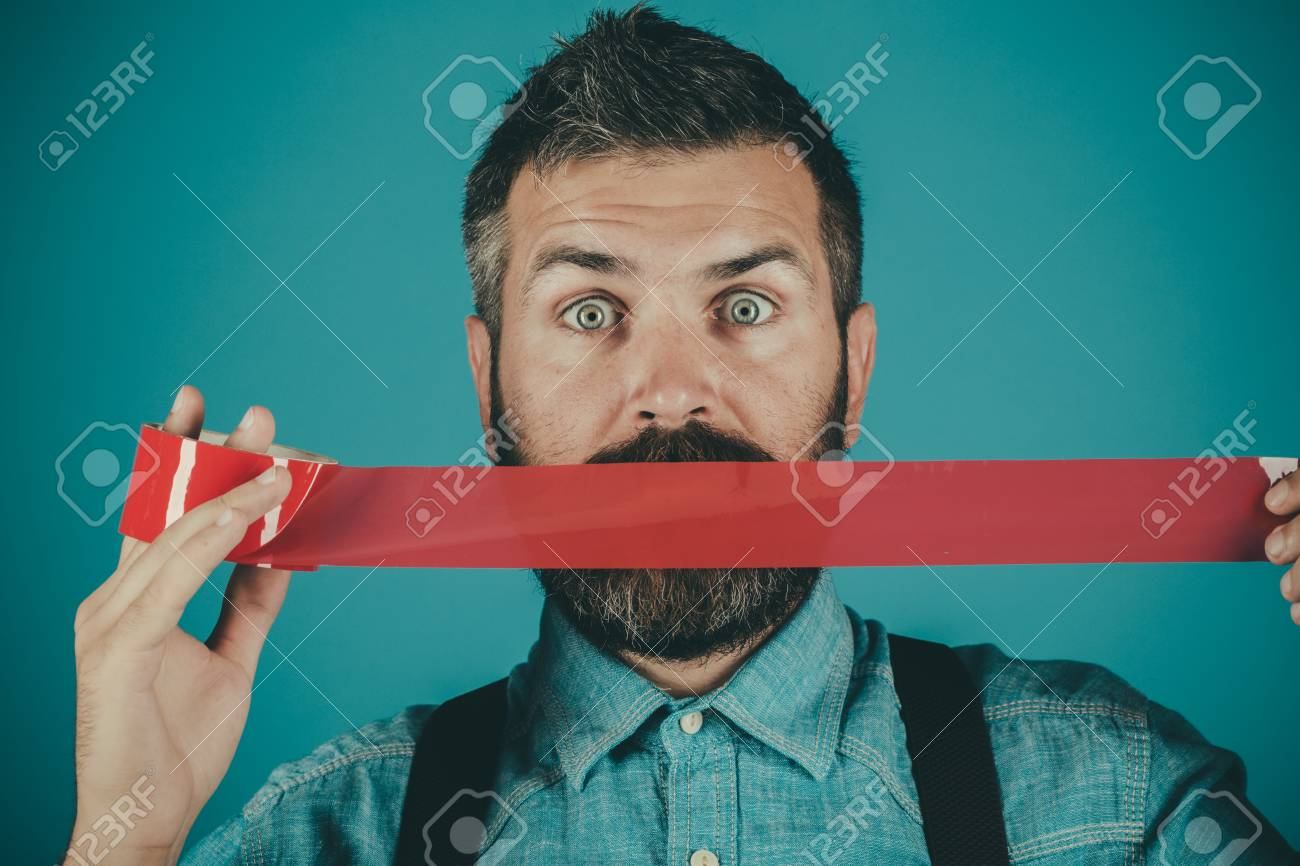 man wrapping mouth by adhesive tape. - 111835687