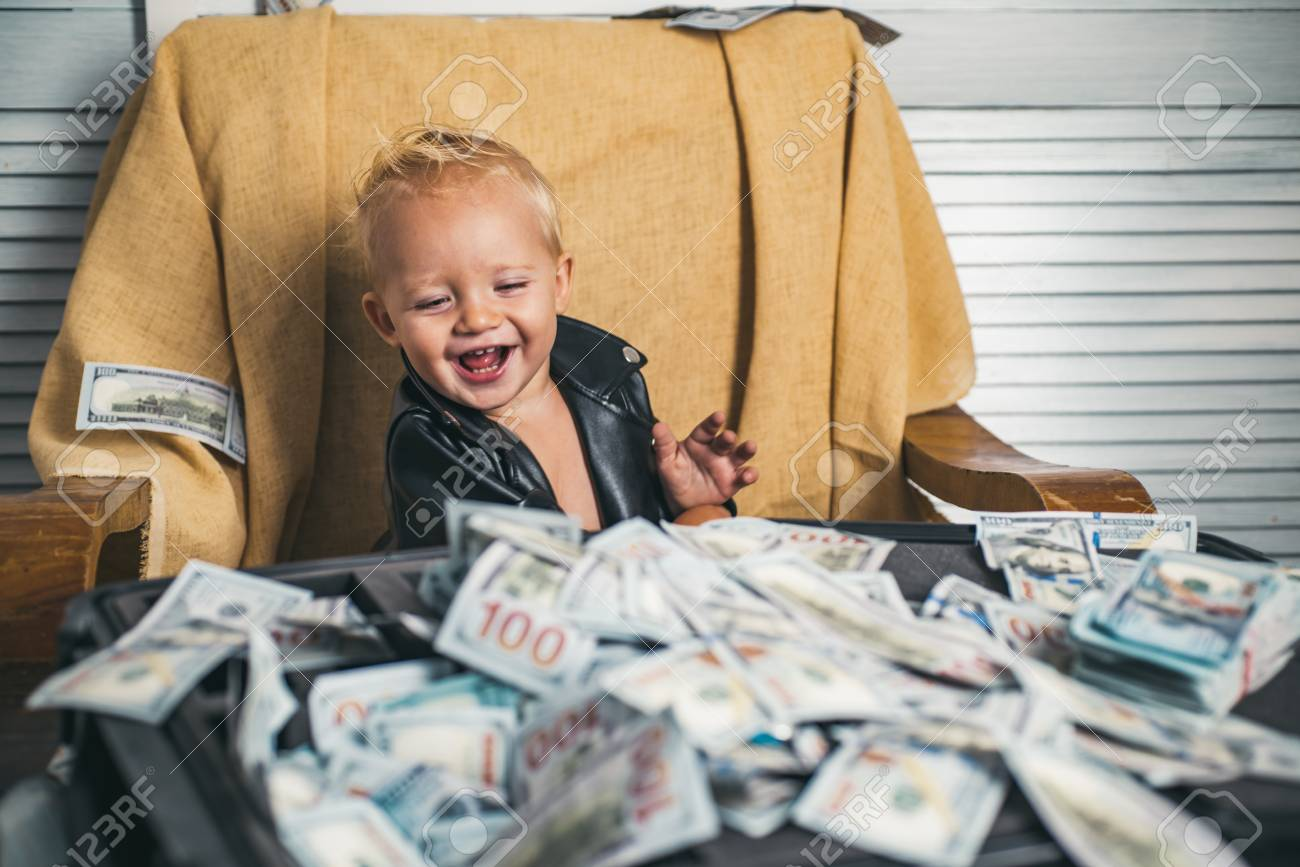 Good deal. Small child do business accounting in startup company. Little entrepreneur work in office. Boy child with money case. Little boy count money in cash. Startup business costs - 112477947