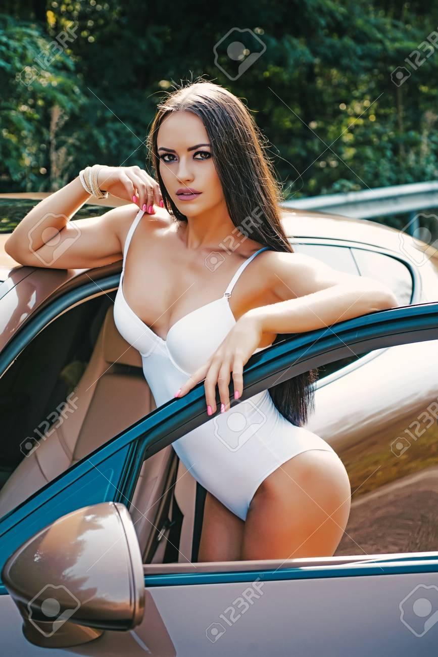 Sport car and luxurious butt woman. Sexy ass near golden brown sports