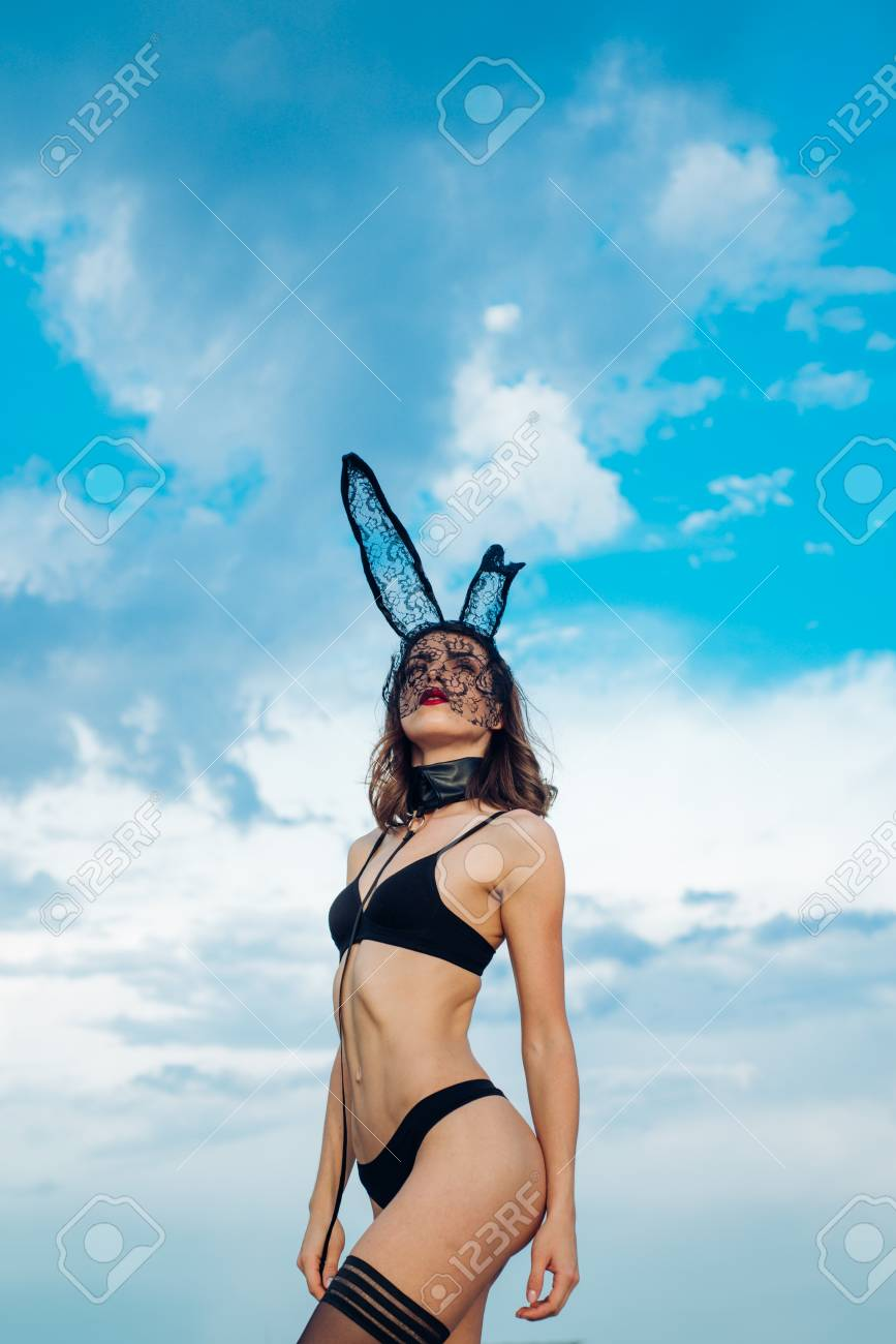 Beautiful Sexy Young Woman Wearing A Black Mask Easter Bunny