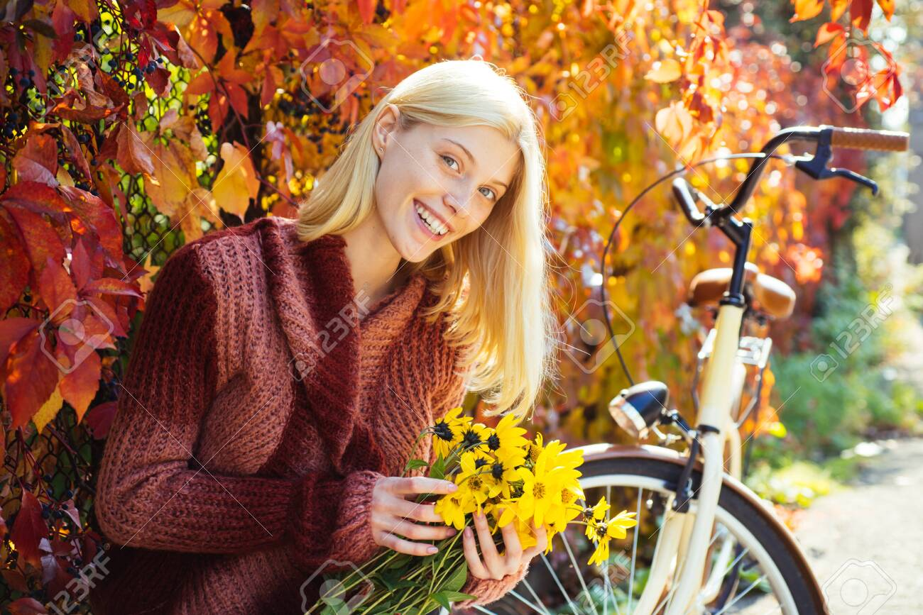 Autumn bouquet. Warm autumn. Girl with bicycle and flowers. Woman bicycle autumn garden. Active leisure and lifestyle. Autumn simple pleasures. Girl ride bicycle for fun. Blonde enjoy relax park - 123083808