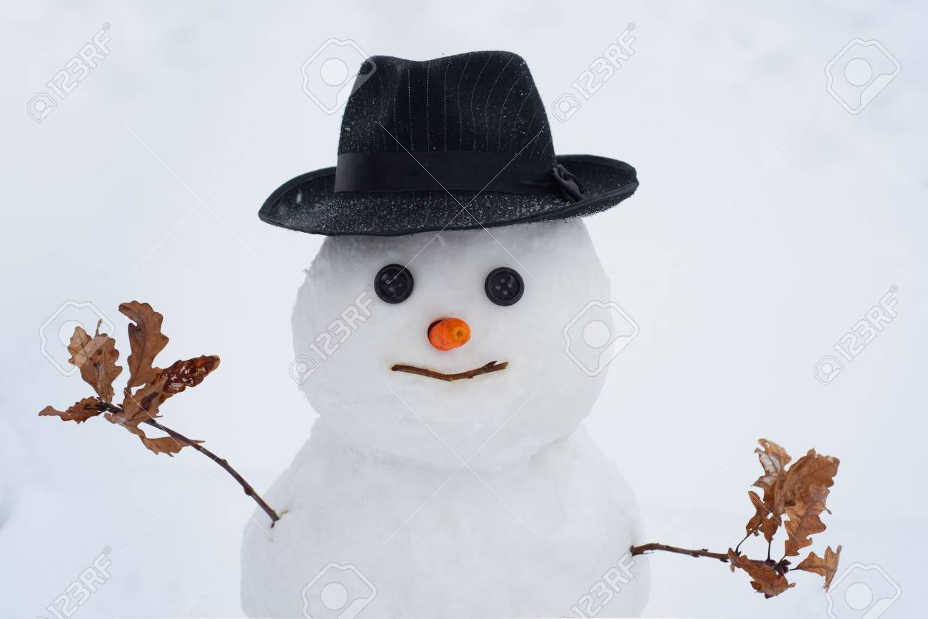 Handmade snowman in the snow outdoor. Christmas snowman on white snow background. Winter holidays sale banner. Winter Art Greeting Card. - 123088422