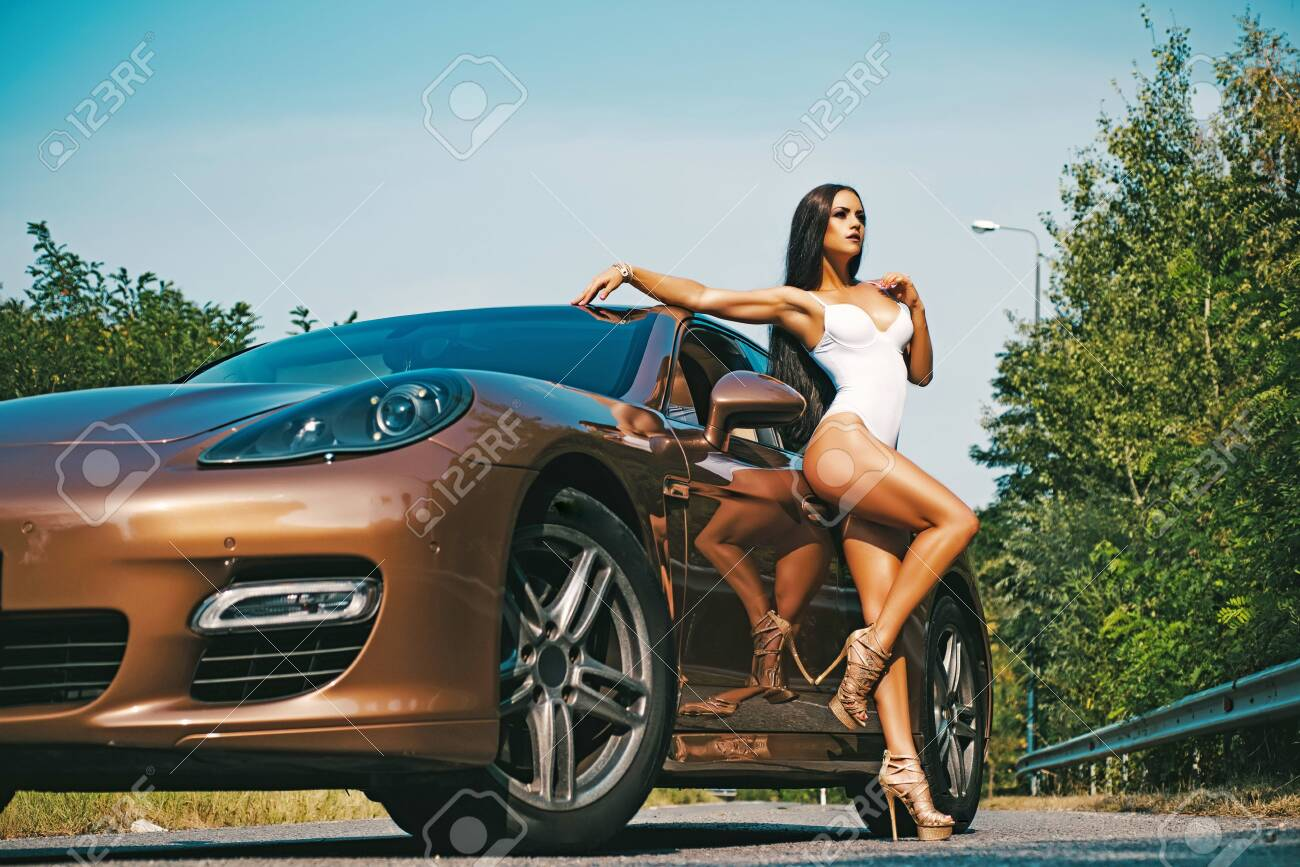 Concept of marketing and advertising exclusive car. Hot model in a transparent baby doll and heels. Healthy body. - 125050439