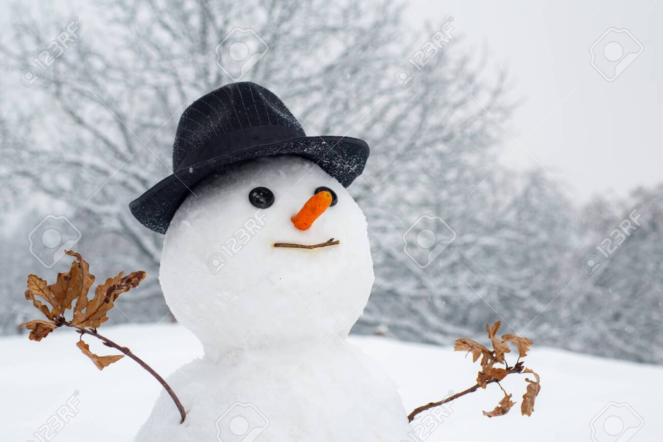 Snowman With Light Star In Christmas Day Snow Man In Winter Stock Photo Picture And Royalty Free Image Image 127791595