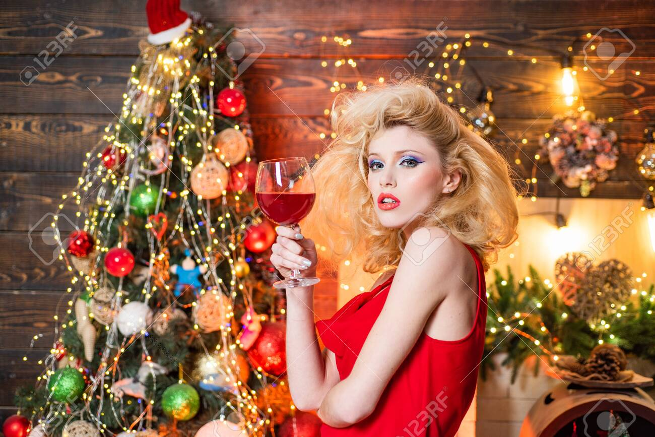 Vintage Christmas girl with retro hairstyle and pinup makeup..