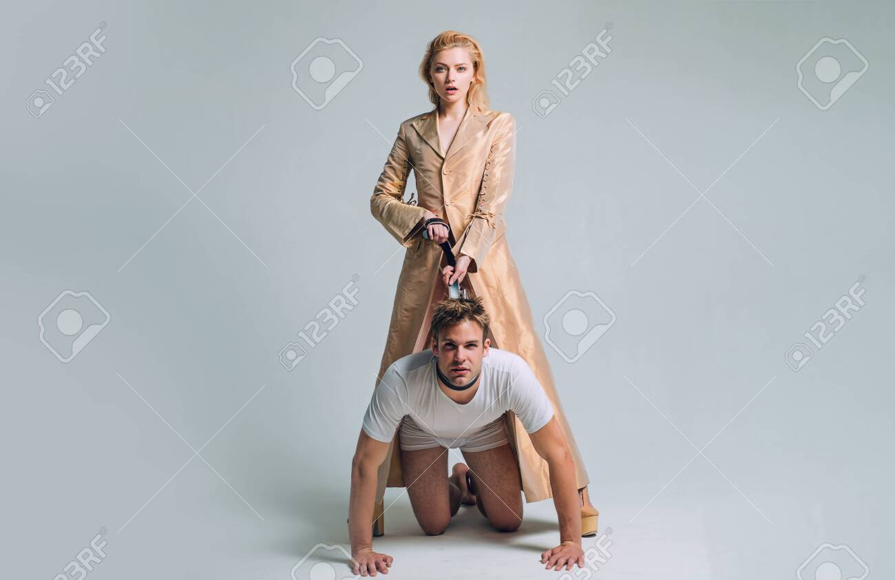 Dominantning. Woman and man playing domination games. Love relations and dominating. Concept of domination and bondage. Dominant womans. - 129321692