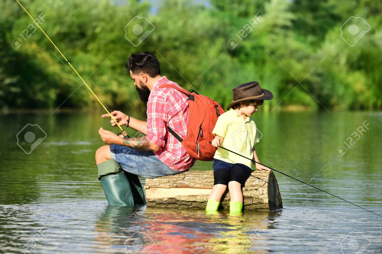 Father and son fishing. Anglers. Father and son relaxing together - 131357135