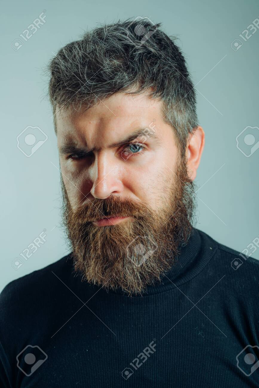 Handsome bearded man. Brutal hipster boy. Confident concept. Urban lifestyle concept. Man with confident face and brutal style isolated. Barbershop advertising. Copy space. - 136808634