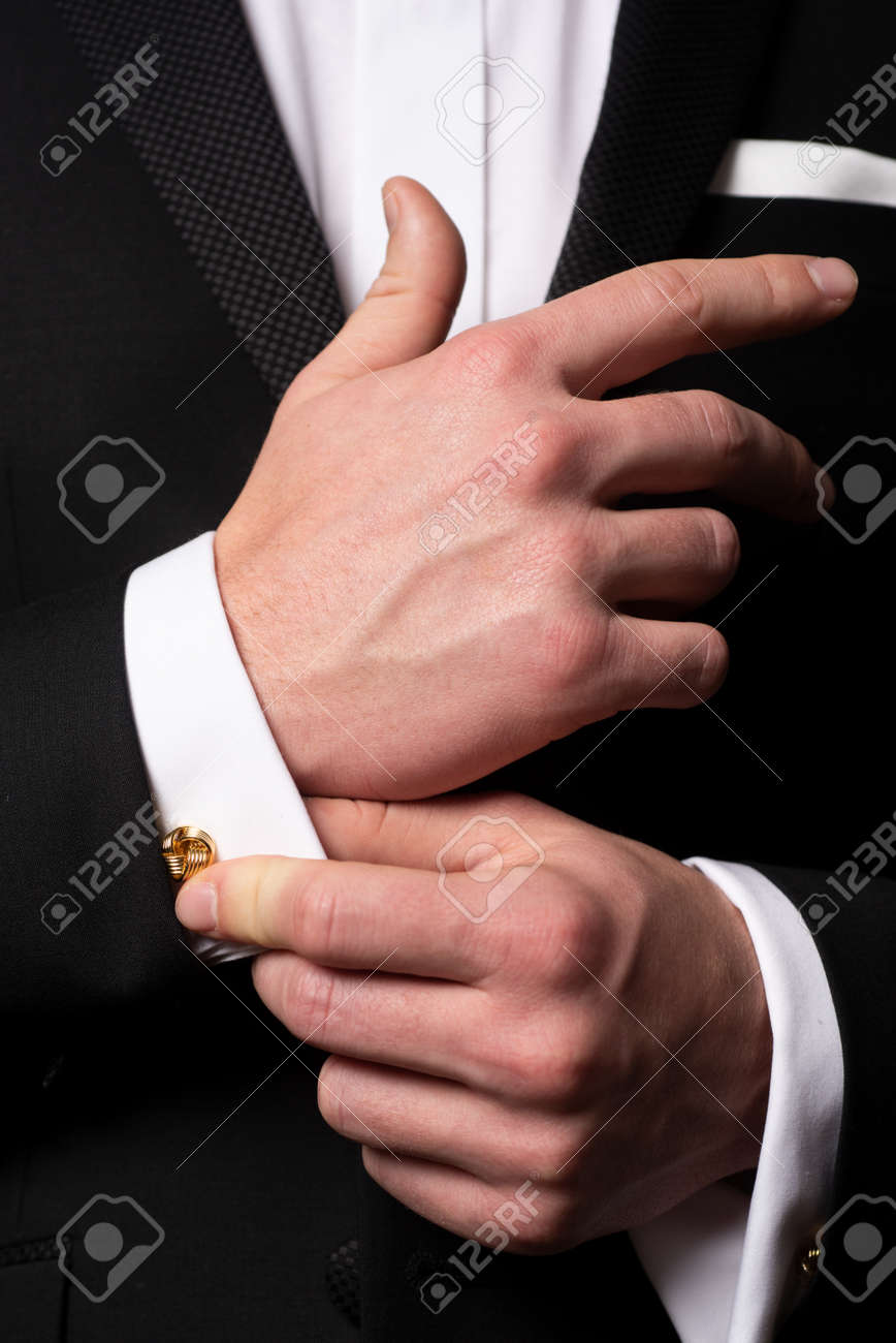 Man fixing cufflinks. Gentleman in black suit. Elegant and stylish clothes. Male fashion. Business look. - 168478149