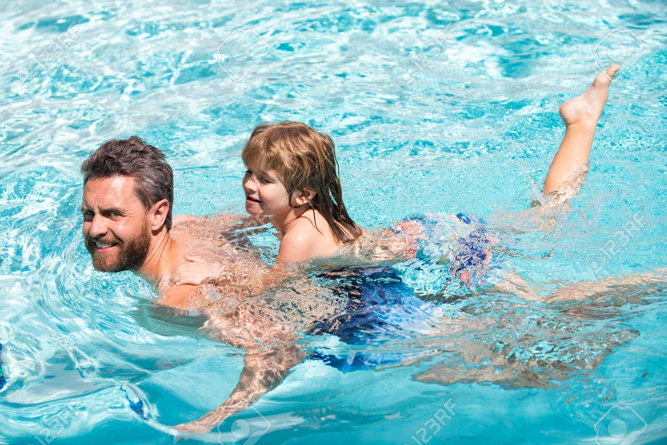 Father and son swimming in pool, summer family. Dad and son leisure. Swimming lessons. - 168903505
