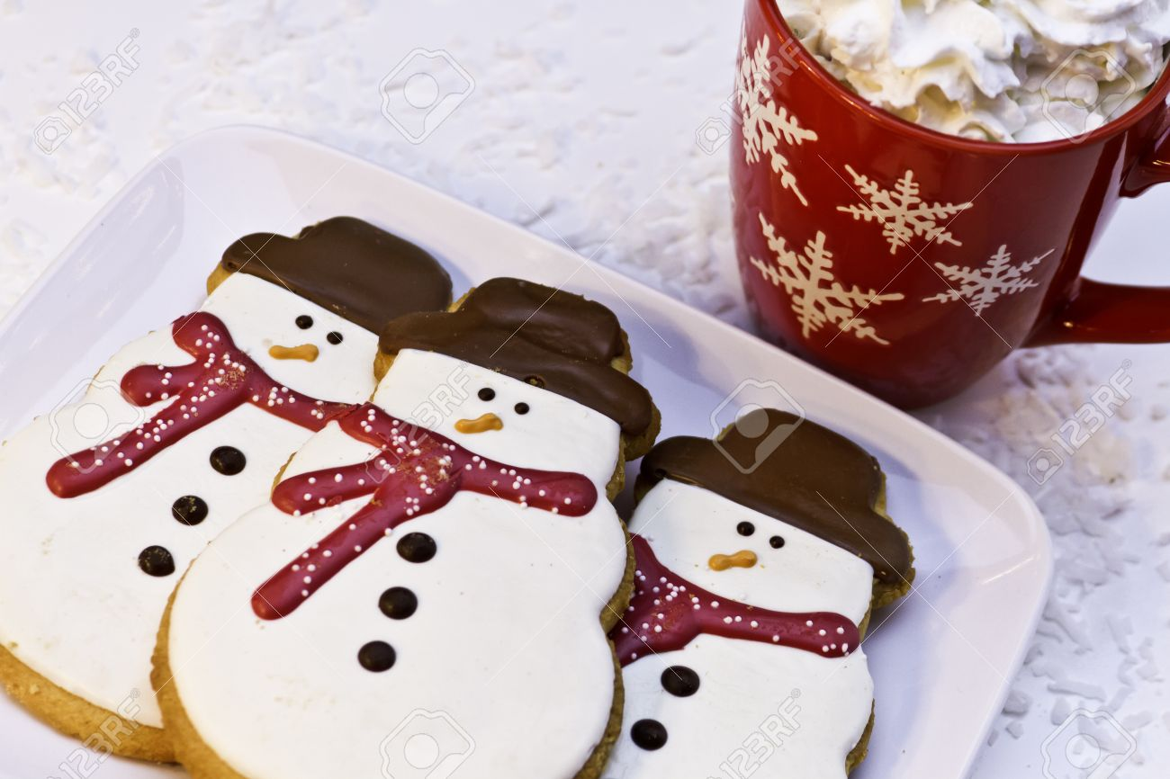 Christmas Cookies In Snowman Shape And Red Mug Of Hot Chocolate