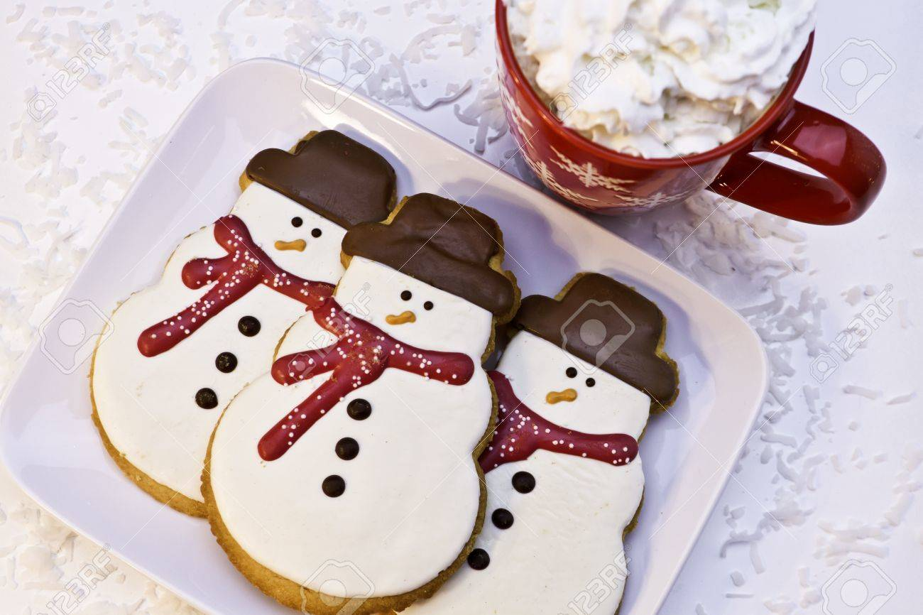 Christmas snowman cookies on white plate Stock Photo - 16510059