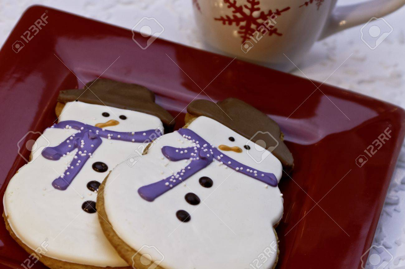 Festive decorated snowman cookies with mug of hot chocolate Stock Photo - 16510133