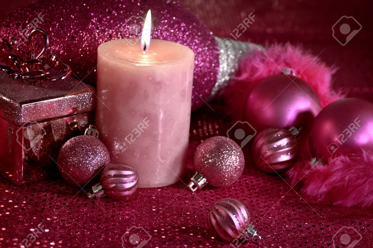 Hot pink Christmas decorations with feather garland, ornaments and lighted candle Stock Photo - 16510218