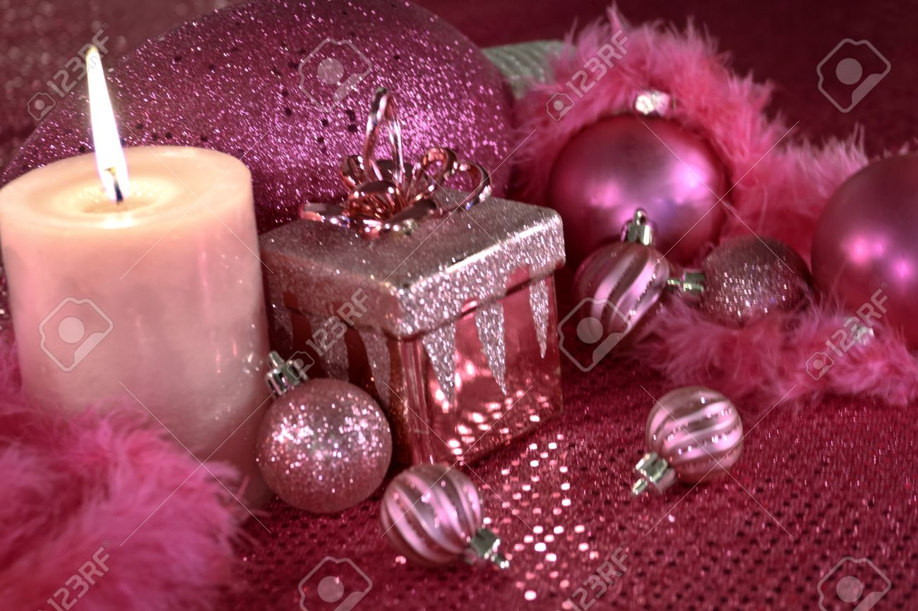 Pink christmas table decorations - Festive Pink Christmas Decorations On Pink Table Cloth With Lighted Candle Stock Photo 16510213