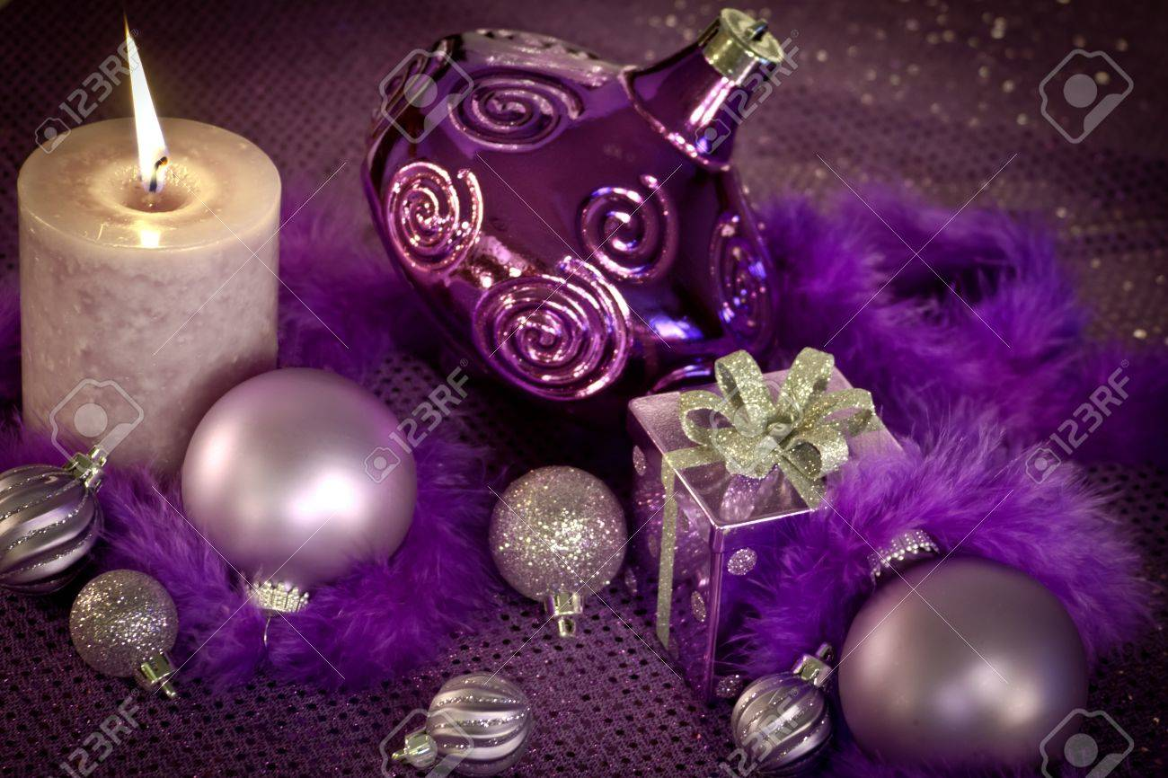 purple christmas decorations with ornaments present and lighted candle stock photo 16510193