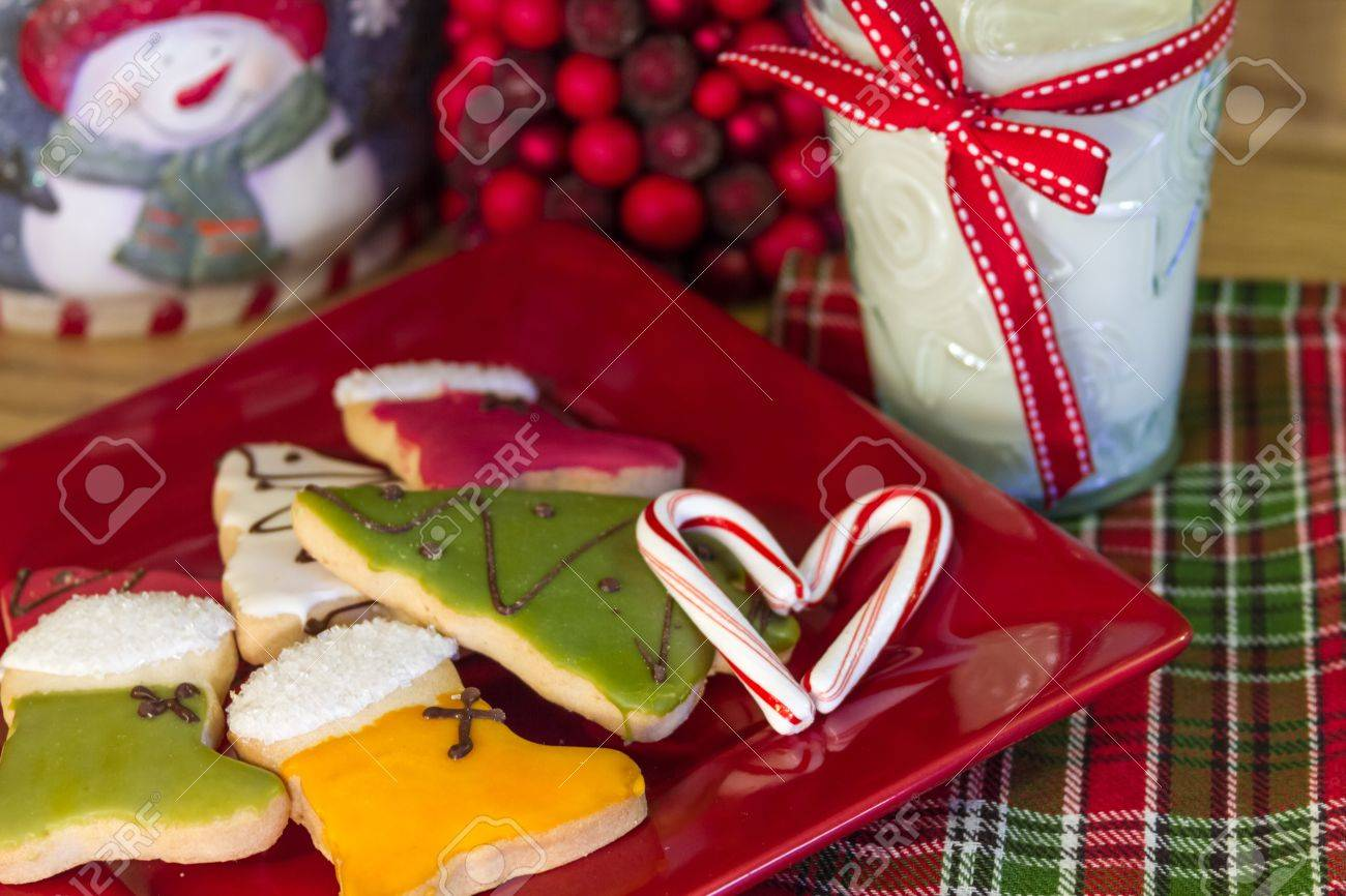 Holiday Decorated Cookies And Milk For Santa With A Candy Cane