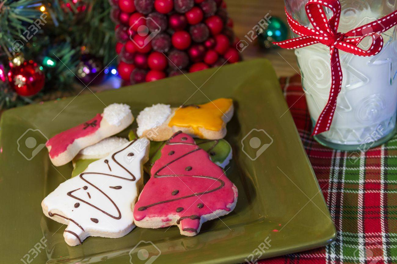 Holiday Table With Frosted Christmas Cookies On Green Plate And ...
