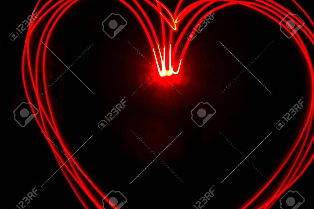 Multiple red heart light streaks made by light painting Stock Photo - 17422914