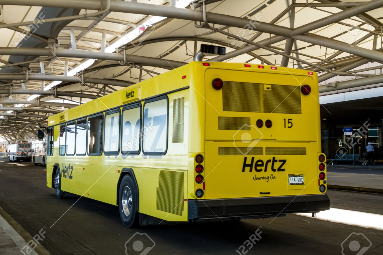 Hertz yellow car rental buses drop off and pickup at denver international airport stock photo