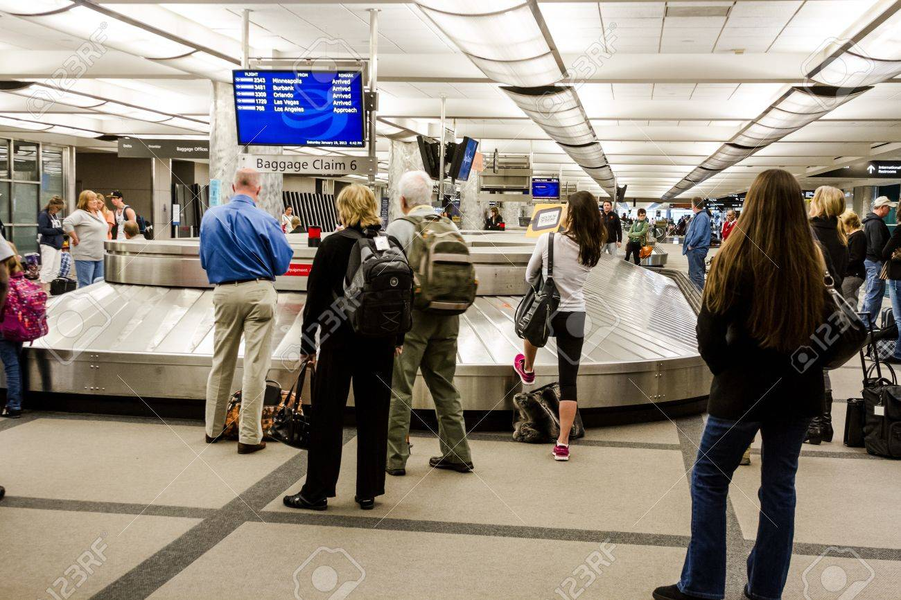 People waiting for luggage at baggage claim carousel Stock Photo - 17403480