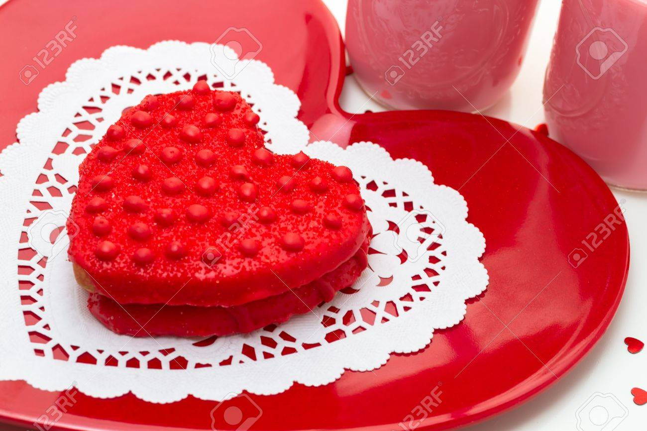 Red Heart Shaped Sugar Cookies On Red Plate Decorated For Valentines