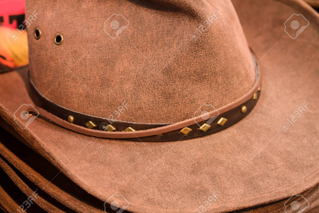 0d5627c35f0d83 Stack Of Brown Mens Cowboy Hats Stock Photo, Picture And Royalty ...