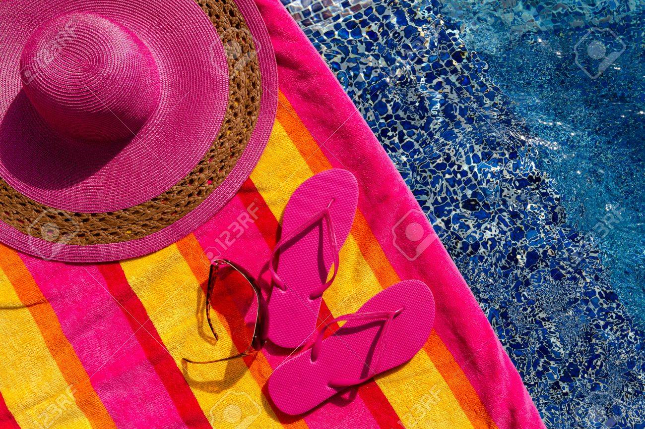 0718b0a9 ... big pink floppy hat. Pair of bright pink flip flops by the pool on a bright  orange, pink,