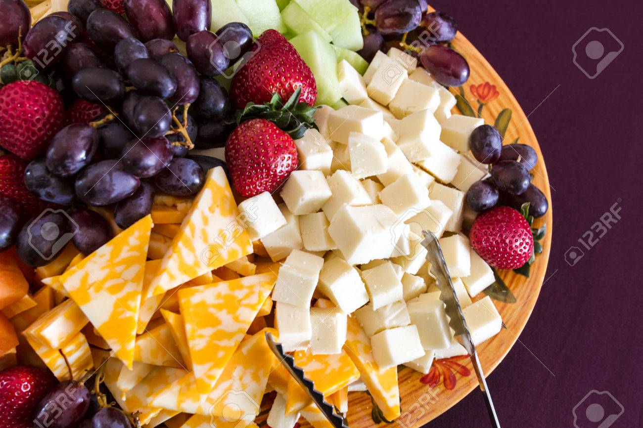 http://previews.123rf.com/images/tvirbickis/tvirbickis1309/tvirbickis130900527/22260138-Party-hors-d-oeuvre-platter-of-assorted-cheeses-and-fruits-from-above-Stock-Photo.jpg