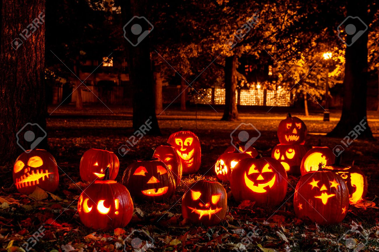 group of candle lit halloween pumpkins in park on fall evening stock photo 23071508 - Fall Pumpkins