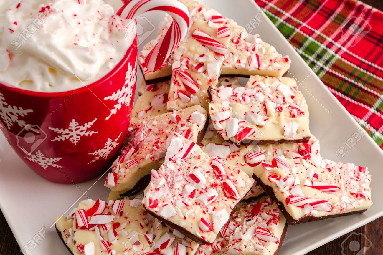 Chocolate Peppermint Bark On White Plate With Red Snowflake Mug ...
