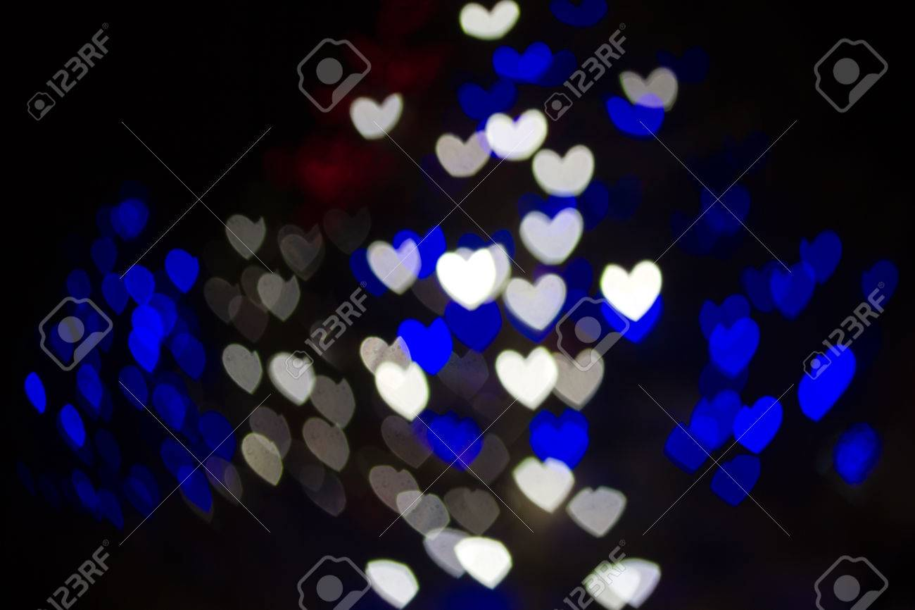 best service d66a1 c689e Abstract heart shaped bokeh background of blue and white Christmas..