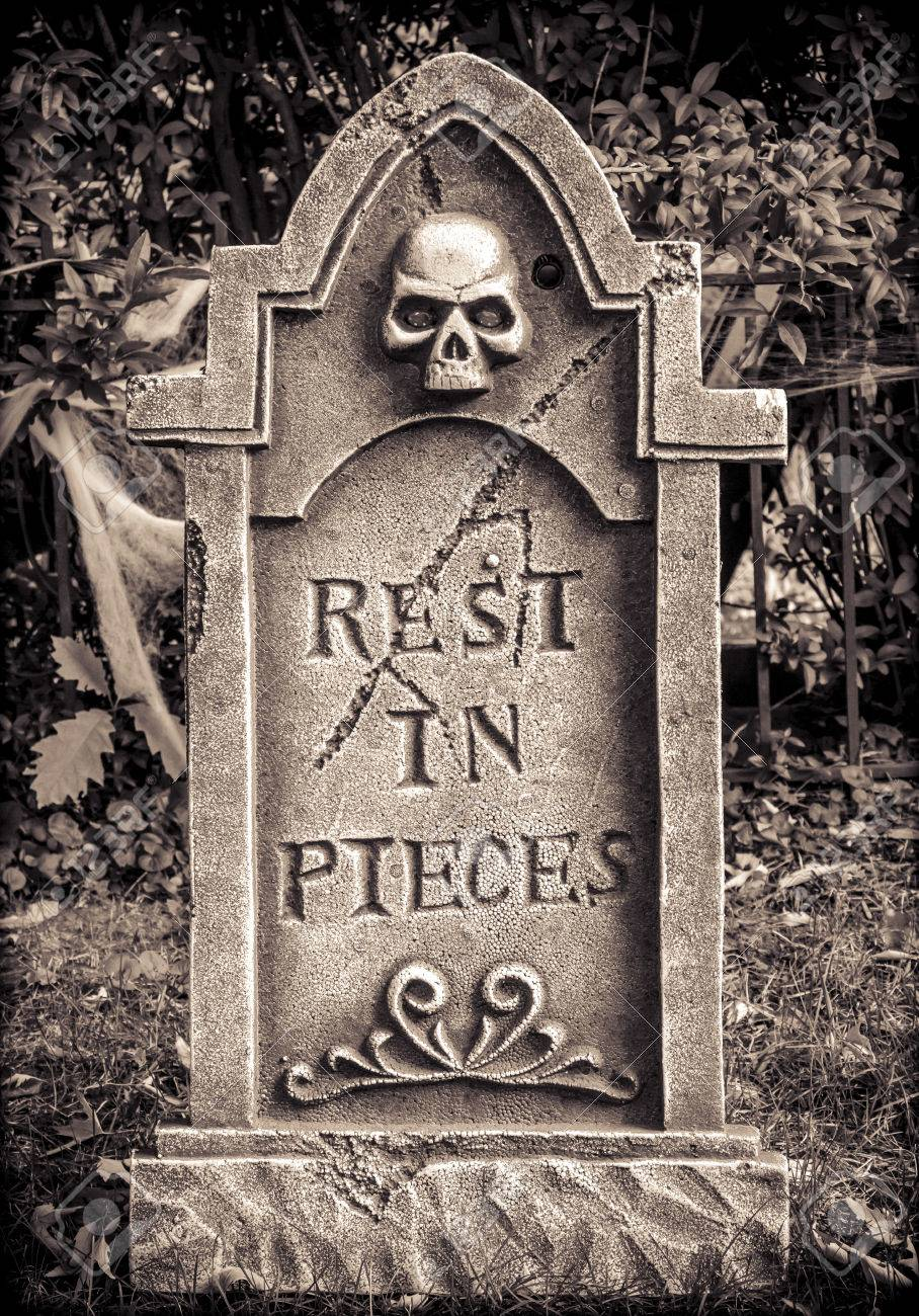 32817364-scary-halloween-skeleton-gravestone-with-rest-in-pieces-message-on-front.jpg