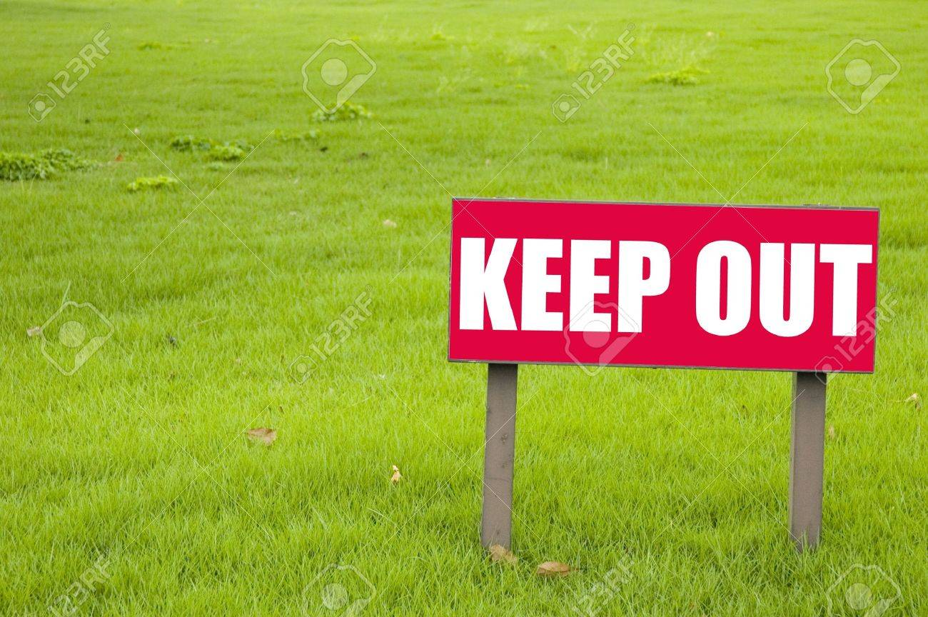 Keep out sign on green grass Stock Photo - 8634385