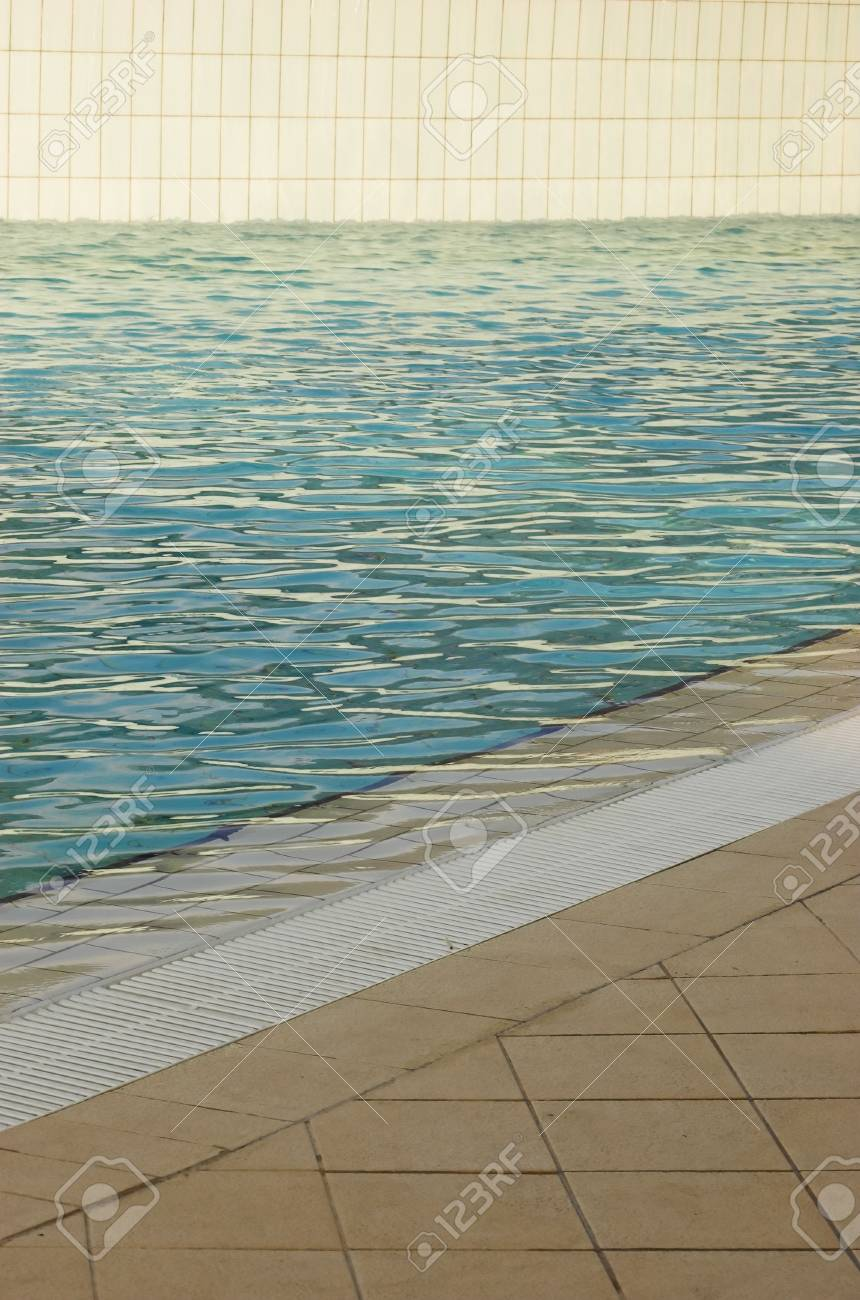 Detail of a white tiled swimming pool