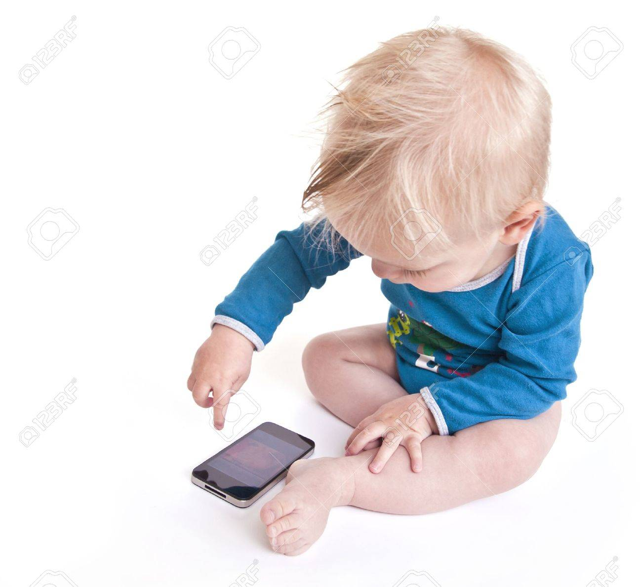 Baby playing with phone Stock Photo - 18574854